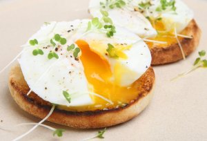 Two poached eggs on a toasted English muffin.